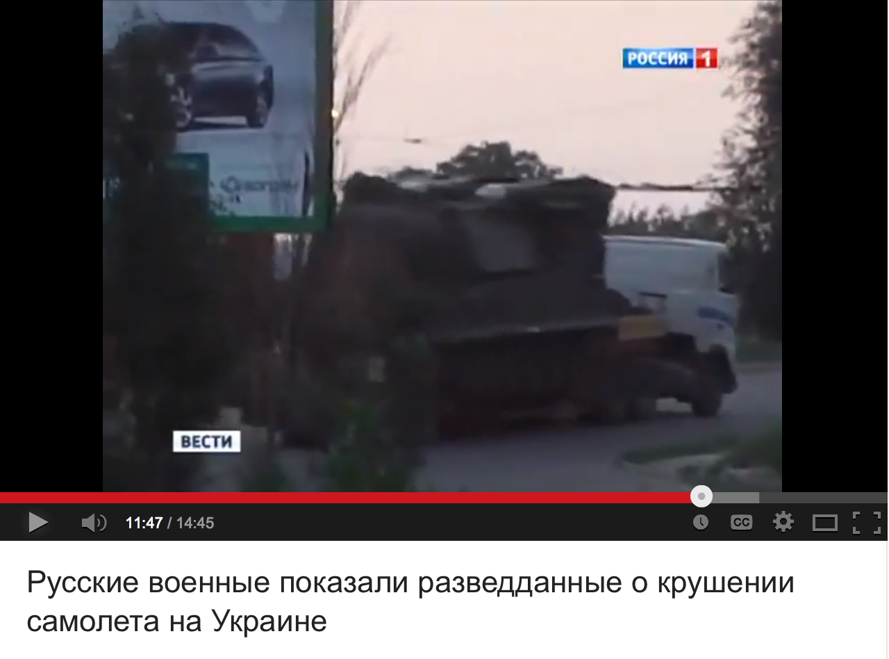 """Russian Defence Ministry pointed out that the Ukro-Zio-Nazi video framing Russian """"rebels"""" for transporting the BUK launcher towards the Russian-Ukrainina border is fake, since its backdrop billboard proves that the video footage was taken in the city occupied by the Ukro-Zio-Nazi."""