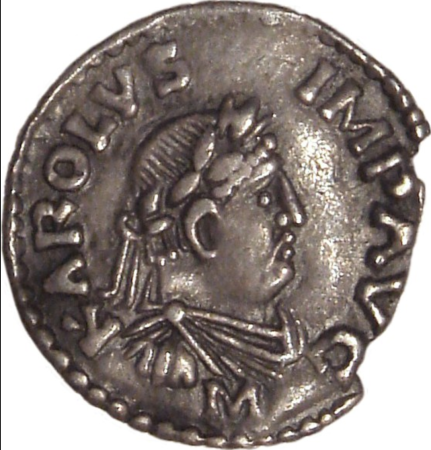 A coin of Charlemagne with the inscription KAROLVS IMP AVG (Karolus Imperator Augustus)