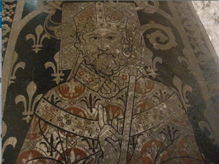 Gammadion on the Stele of bishop Raoul Beaumont at the Angers cathedral in France, 12th century.