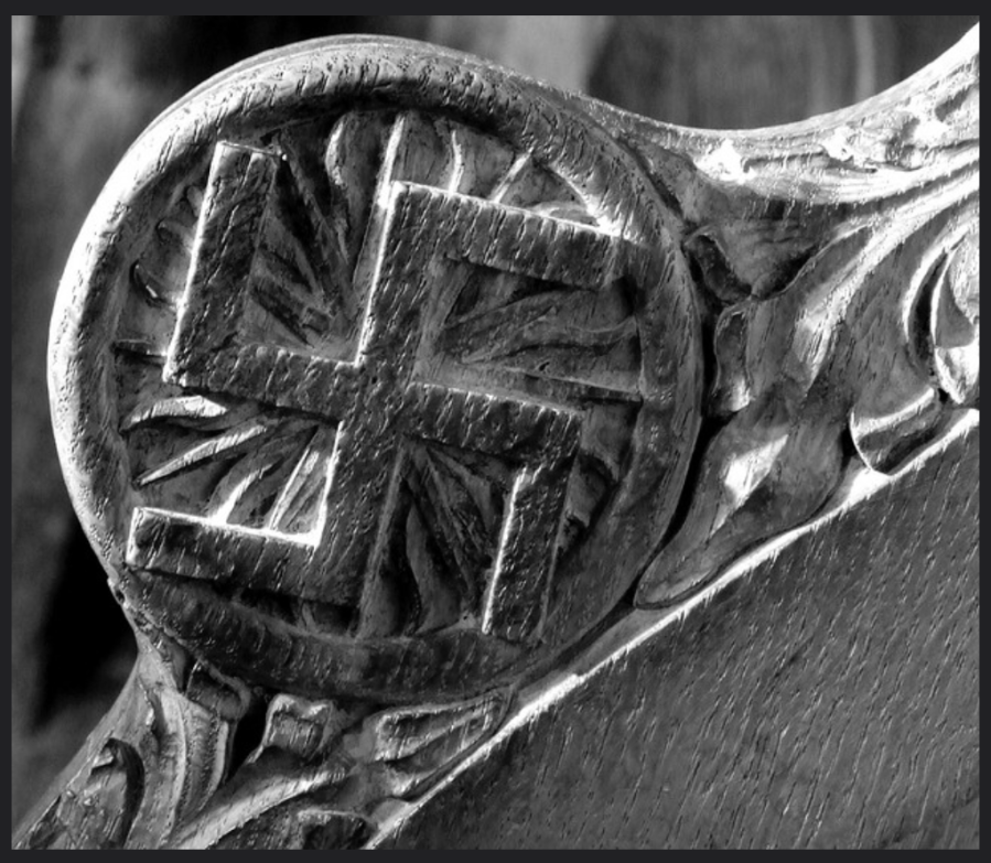 Swastika carved on the end of a pew stall in Sheffield Cathedral / The Cathedral Church of St Peter and St Paul, England, 12th century.