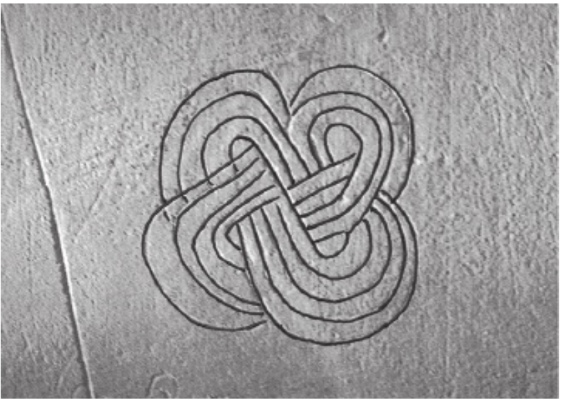 Gammadion, as Swastika Pelta, also known as a Fylfot Cross, is commonly found amongst the graffiti in the Saints Church, Litcham, Norfolk, England, 12th century.